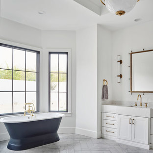 Bathroom - large farmhouse master white tile and marble tile marble floor and gray floor bathroom idea in Phoenix with shaker cabinets, white cabinets, a one-piece toilet, white walls, an undermount sink, quartz countertops, a hinged shower door and gray countertops