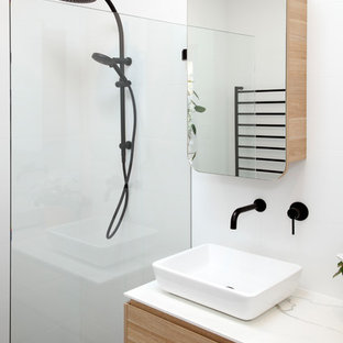This is an example of a small modern 3/4 bathroom in Sydney with flat-panel cabinets, light wood cabinets, a double shower, white tile, porcelain tile, concrete floors, a vessel sink, solid surface benchtops, purple floor, an open shower and white benchtops.