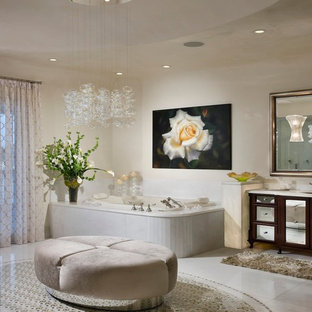 Inspiration for a contemporary beige tile bathroom remodel in Miami with a hot tub