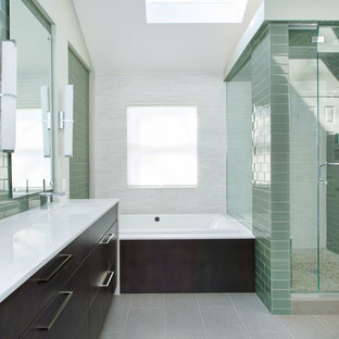 Example of a mid-sized trendy master green tile and glass tile porcelain floor bathroom design in Kansas City with an undermount sink, flat-panel cabinets, dark wood cabinets, engineered quartz countertops and green walls
