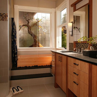 Example of a zen mosaic tile bathroom design in Seattle