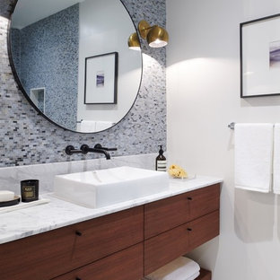 Bathroom - mid-sized contemporary master gray tile and mosaic tile mosaic tile floor and white floor bathroom idea in Toronto with flat-panel cabinets, dark wood cabinets, white walls, a vessel sink and marble countertops