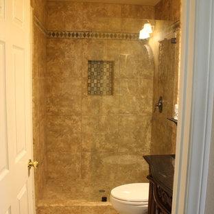 Ispirazione per una piccola stanza da bagno con doccia chic con consolle stile comò, ante in legno bruno, top in granito, piastrelle multicolore, piastrelle in gres porcellanato, doccia aperta, pareti beige e pavimento in gres porcellanato