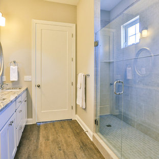 Example of a mid-sized trendy master gray tile double shower design in Minneapolis with a drop-in sink, flat-panel cabinets, white cabinets, granite countertops and beige walls