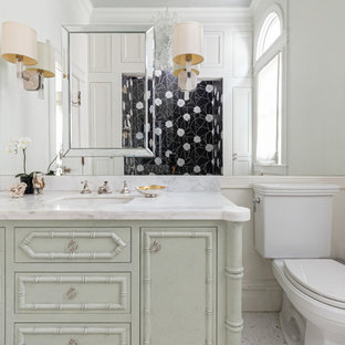 Inspiration for a mid-sized timeless bathroom remodel in San Francisco with gray cabinets, a two-piece toilet, white walls, an undermount sink, white countertops, furniture-like cabinets and a hinged shower door