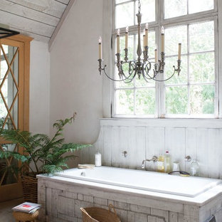 Example of a large cottage chic master drop-in bathtub design in Austin with white walls