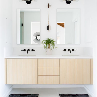 Example of a mid-sized danish master white tile ceramic tile and white floor bathroom design in Los Angeles with flat-panel cabinets, light wood cabinets, white walls, an undermount sink, quartz countertops and a hinged shower door