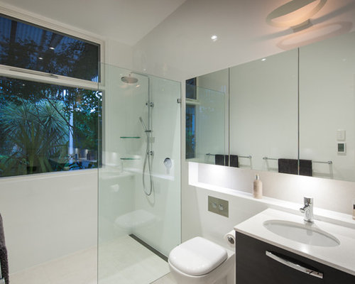 example of a small minimalist master doorless shower design in adelaide with an undermount sink - Minimalist Bathroom Design