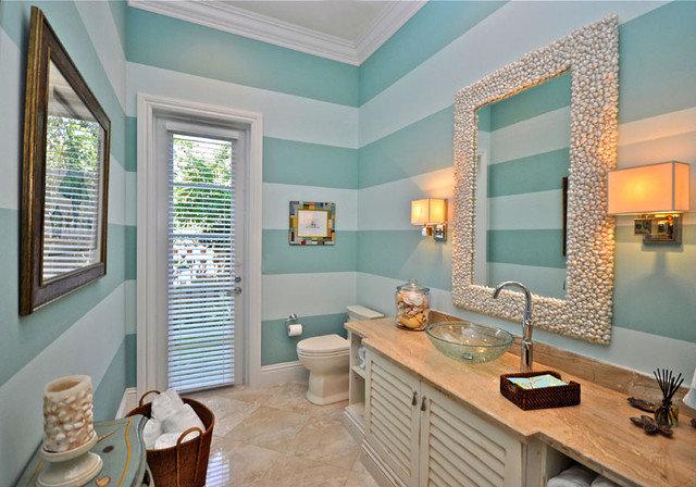 Tropical Bathroom by Lighthouse Interiors