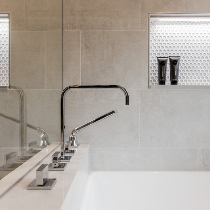 Bathroom - large modern master gray tile and cement tile ceramic tile and gray floor bathroom idea in Detroit with flat-panel cabinets, dark wood cabinets, gray walls, an undermount sink, quartz count