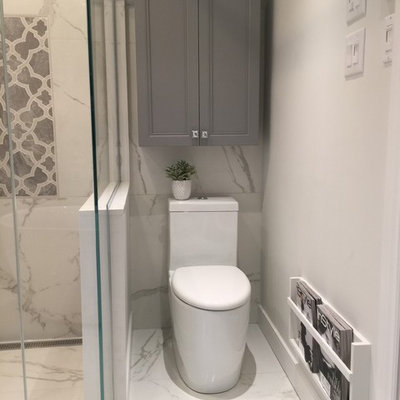 Inspiration for a large transitional master white tile and porcelain tile porcelain tile bathroom remodel in Montreal with furniture-like cabinets, gray cabinets, a one-piece toilet, gray walls, an undermount sink and quartz countertops