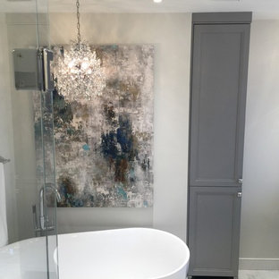 Bathroom - large transitional master white tile and porcelain tile porcelain floor bathroom idea in Montreal with furniture-like cabinets, gray cabinets, a one-piece toilet, gray walls, an undermount sink and engineered quartz countertops