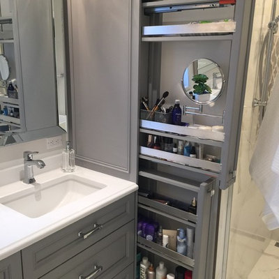 Large transitional master white tile and porcelain tile porcelain tile bathroom photo in Montreal with furniture-like cabinets, gray cabinets, a one-piece toilet, gray walls, an undermount sink and quartz countertops