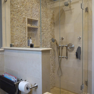 Doorless shower - small mediterranean beige tile and stone tile limestone floor doorless shower idea in Boston with a console sink, beaded inset cabinets, dark wood cabinets, limestone countertops, a two-piece toilet and blue walls