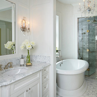 Inspiration for a huge timeless master gray tile and stone tile marble floor bathroom remodel in Chicago with an undermount sink, recessed-panel cabinets, white cabinets, marble countertops and white walls