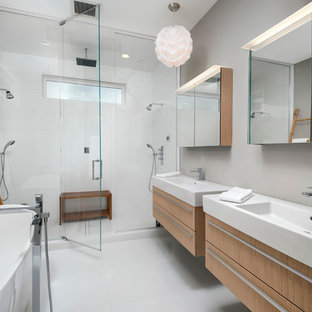 Bathroom - contemporary master white tile and porcelain tile porcelain floor bathroom idea in Chicago with flat-panel cabinets, light wood cabinets, gray walls, an integrated sink and a hinged shower door