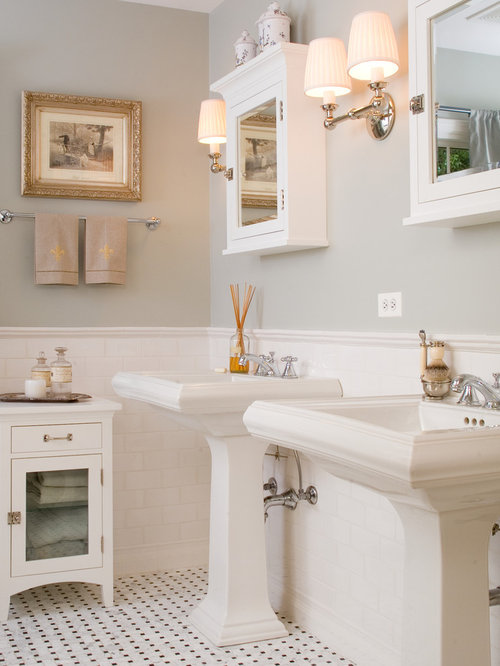 Simple Bathroom Design Ideas, Remodels & Photos with a Pedestal Sink and White Cabinets