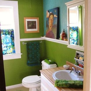 Inspiration for an eclectic master linoleum floor bathroom remodel in Grand Rapids with a drop-in sink, white cabinets, wood countertops, a one-piece toilet and green walls