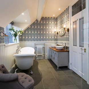 Medium sized victorian family bathroom in Surrey with shaker cabinets, grey cabinets, a freestanding bath, a walk-in shower, a two-piece toilet, grey tiles, slate tiles, grey walls, slate flooring, a console sink, wooden worktops, grey floors, an open shower and brown worktops.
