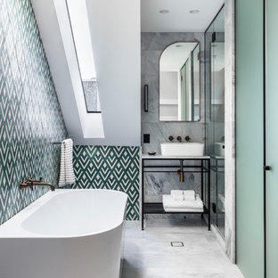 This is an example of a transitional bathroom in Sydney with a freestanding tub, multi-coloured tile, white walls, a vessel sink and grey floor.