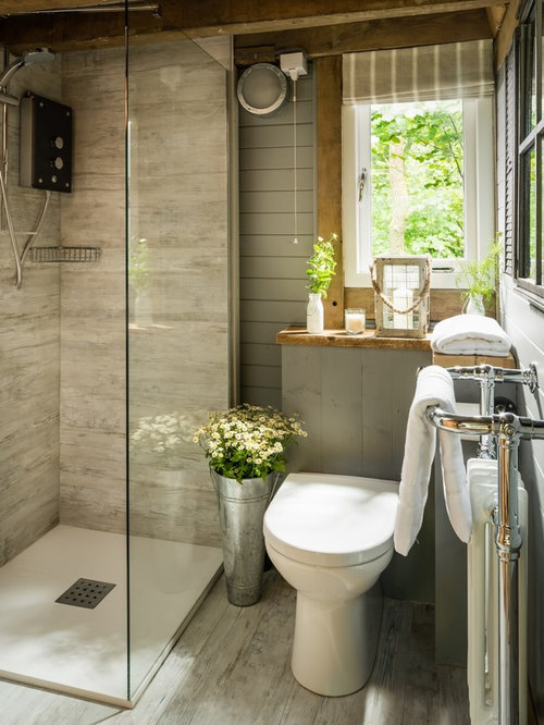 inspiration for a small rustic master gray tile and ceramic tile light wood floor and gray - Rustic Bathroom