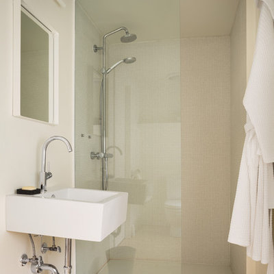 Example of a mountain style 3/4 light wood floor alcove shower design in Portland Maine with a wall-mount sink and white walls