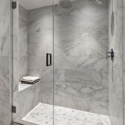 Transitional gray tile and white tile mosaic tile floor alcove shower photo in New York with gray walls and a hinged shower door
