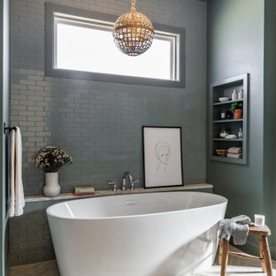 Large transitional master gray tile and ceramic tile brick floor and beige floor freestanding bathtub photo in Dallas with gray walls and a niche