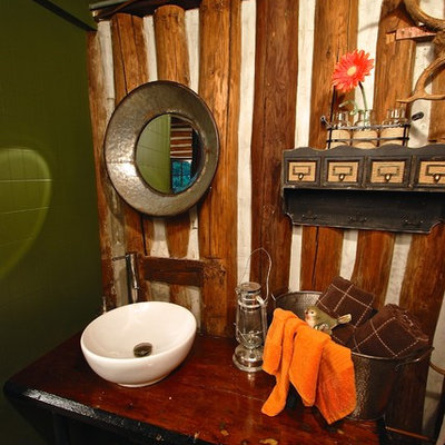 Inspiration for a small rustic 3/4 plywood floor bathroom remodel in Philadelphia with a drop-in sink, wood countertops, a one-piece toilet, brown walls and brown countertops