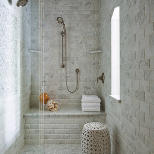 Photo of a classic bathroom in Minneapolis with an alcove shower, grey tiles, marble tiles and a shower bench.