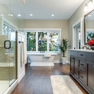 Свежая идея для дизайна: большая главная ванная комната в стиле современная классика с фасадами в стиле шейкер, темными деревянными фасадами, отдельно стоящей ванной, угловым душем, бежевыми стенами, врезной раковиной, коричневым полом, душем с распашными дверями, коричневой столешницей, тумбой под две раковины, встроенной тумбой и панелями на стенах - отличное фото интерьера