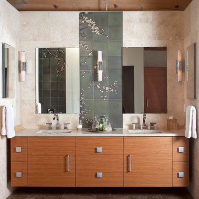 Freestanding bathtub - large contemporary master green tile and ceramic tile marble floor freestanding bathtub idea in Denver with an undermount sink, flat-panel cabinets, medium tone wood cabinets, marble countertops, a wall-mount toilet, beige walls and beige countertops