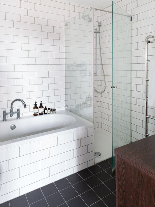 drop in tub white tile subway tile white walls and slate floors