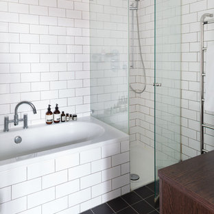 Inspiration for a mid-sized scandinavian master white tile and subway tile slate floor bathroom remodel in London with dark wood cabinets, wood countertops and white walls
