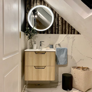 Design ideas for a medium sized contemporary family bathroom in London with flat-panel cabinets, light wood cabinets, black and white tiles, porcelain tiles, black walls, porcelain flooring, solid surface worktops, white floors, an integrated sink and white worktops.
