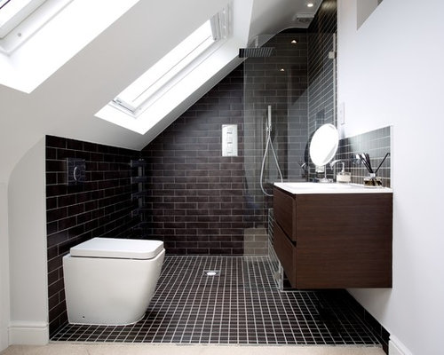 this is an example of a modern bathroom in london with flat panel cabinets