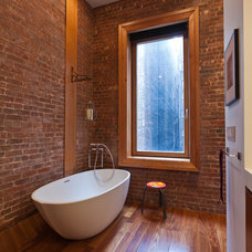 Industrial Bathroom by JENDRETZKI LLC