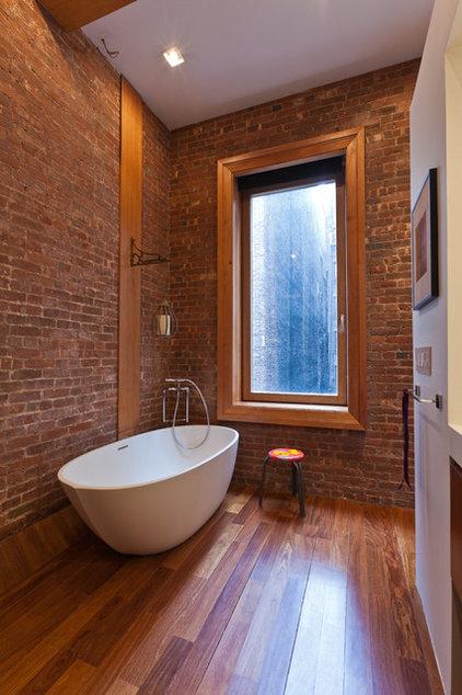 Industrial Bathroom by JENDRETZKI LLC