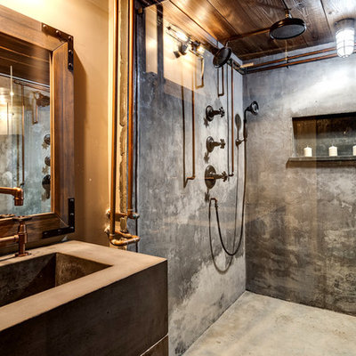 Urban master concrete floor and gray floor bathroom photo in Atlanta with concrete countertops, gray countertops, flat-panel cabinets, gray cabinets, brown walls and an integrated sink