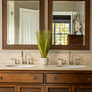 Bathroom - tropical beige tile and mosaic tile bathroom idea in Charlotte with an undermount sink, shaker cabinets and gray walls