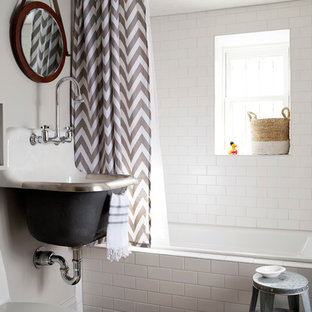 Small transitional kids' white tile and subway tile ceramic floor bathroom photo in DC Metro with a wall-mount sink, white walls, gray cabinets and a one-piece toilet