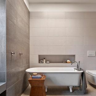 Example of a trendy master gray tile gray floor claw-foot bathtub design in Philadelphia