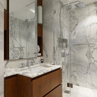 Design ideas for a contemporary shower room bathroom in London with flat-panel cabinets, medium wood cabinets, grey tiles, white tiles, a submerged sink, a hinged door, an alcove shower, stone slabs and multi-coloured worktops.