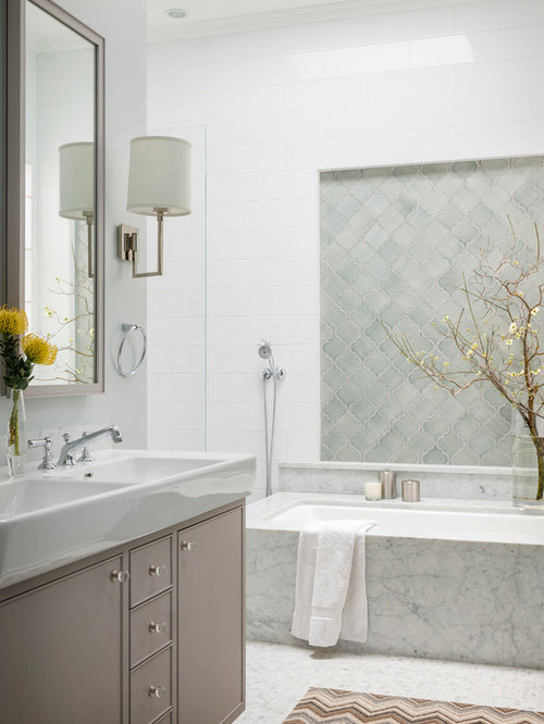 example of a blue tile bathroom design in san francisco with an integrated sink