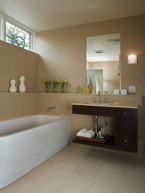 Inspiration For A Modern Beige Tile Freestanding Bathtub Remodel In Chicago  With An Undermount Sink,