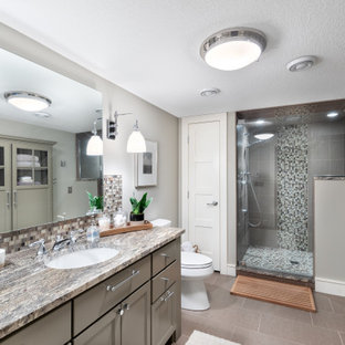 Alcove shower - transitional master mosaic tile gray floor alcove shower idea in Minneapolis with beaded inset cabinets, gray cabinets, gray walls, an undermount sink, a hinged shower door and multicolored countertops