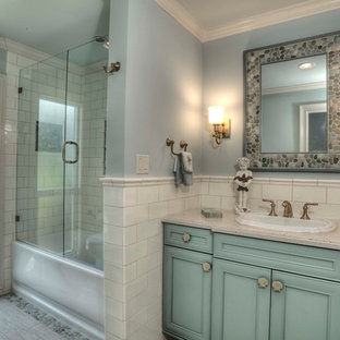 Inspiration for a large transitional 3/4 white tile and subway tile porcelain floor bathroom remodel in Tampa with beaded inset cabinets, turquoise cabinets, blue walls, a drop-in sink and laminate countertops