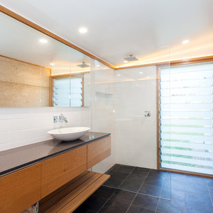 Photo of a mid-sized modern master bathroom in Central Coast with furniture-like cabinets, light wood cabinets, an open shower, white tile, stone tile, white walls, slate floors, a vessel sink, engineered quartz benchtops, black floor, an open shower and black benchtops.