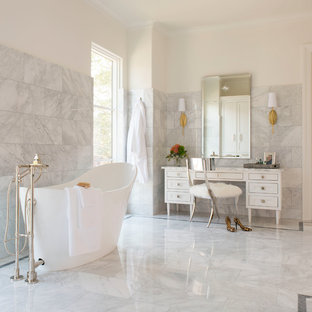 Freestanding bathtub - mid-sized mediterranean master gray tile marble floor and white floor freestanding bathtub idea in Dallas with white cabinets, white walls, marble countertops and furniture-like cabinets