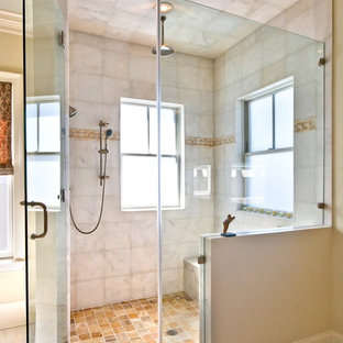 Example of a classic beige tile alcove shower design in Charleston